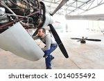 aircraft mechanic repairs an... | Shutterstock . vector #1014055492