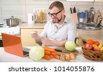 man sitting at kitchen table in ... | Shutterstock . vector #1014055876