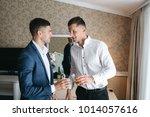 the groom and groomsman... | Shutterstock . vector #1014057616