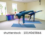 boy and girl perform yoga... | Shutterstock . vector #1014065866