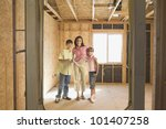 family with blueprints on... | Shutterstock . vector #101407258