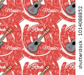 seamless guitar pattern on... | Shutterstock .eps vector #1014088852