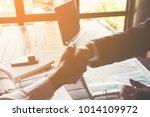 business partners handshaking... | Shutterstock . vector #1014109972
