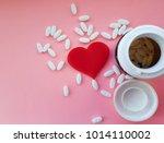 bottle and white medical pills... | Shutterstock . vector #1014110002
