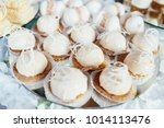 white cookies  served on white... | Shutterstock . vector #1014113476