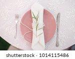 green branch  white serviette... | Shutterstock . vector #1014115486