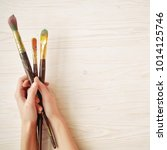 top view of hands with brushes. ...   Shutterstock . vector #1014125746