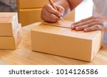 hands of man writing address.... | Shutterstock . vector #1014126586