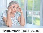 tired senior woman | Shutterstock . vector #1014129682