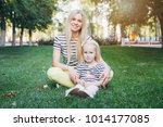 young beautiful mother and her... | Shutterstock . vector #1014177085