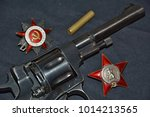 Small photo of Revolver of the Nagan system and the Order of the Red Star