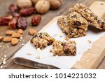 raw vegan bars on a wood table | Shutterstock . vector #1014221032