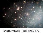 abstract glitter bokeh on black ... | Shutterstock . vector #1014267472