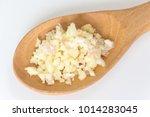 wooden spoon of chopped garlic... | Shutterstock . vector #1014283045