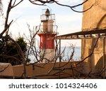 mediterranean lighthouse in old ... | Shutterstock . vector #1014324406