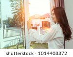 asian woman wake up in the... | Shutterstock . vector #1014403372