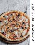 italian pizza on the wooden... | Shutterstock . vector #1014425416
