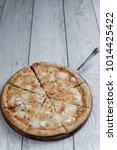 italian pizza on the wooden... | Shutterstock . vector #1014425422