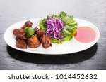 roasted spare ribs served with... | Shutterstock . vector #1014452632