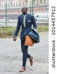 Small photo of MILAN - JANUARY 15: Elegant man with blue suit before Pal Zileri fashion show, Milan Fashion Week street style on January 15, 2018 in Milan.