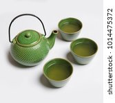 green tea pot and cups on white ...   Shutterstock . vector #1014475372