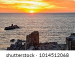 sunset at the tojinbo cliffs by ... | Shutterstock . vector #1014512068