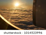 sunset from an aeroplane ... | Shutterstock . vector #1014523996