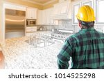 male contractor with hard hat... | Shutterstock . vector #1014525298
