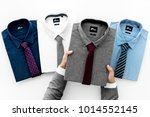 businessman selecting shirt to... | Shutterstock . vector #1014552145