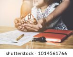 hands of family together... | Shutterstock . vector #1014561766