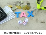 aphabet word tax on a blue... | Shutterstock . vector #1014579712