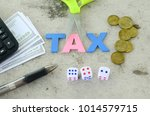 aphabet word tax on a blue... | Shutterstock . vector #1014579715