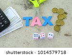 aphabet word tax on a blue... | Shutterstock . vector #1014579718