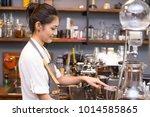 asian barista woman making...   Shutterstock . vector #1014585865