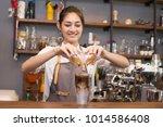 asian barista woman making...   Shutterstock . vector #1014586408