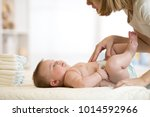 mother taking care of infant... | Shutterstock . vector #1014592966