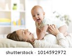 happy family mother playing... | Shutterstock . vector #1014592972