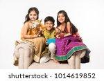 3 indian kids or siblings in... | Shutterstock . vector #1014619852