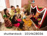 indian  family performing... | Shutterstock . vector #1014628036