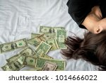 girl with a lot of dollars in... | Shutterstock . vector #1014666022