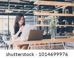 asian businesswoman analyze... | Shutterstock . vector #1014699976