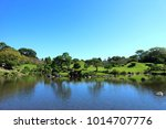lake with deciduous forest...   Shutterstock . vector #1014707776