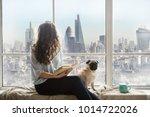london view from window. woman...   Shutterstock . vector #1014722026