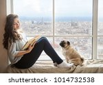 Adorable Woman With Her Dog...