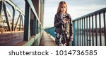 a girl wearing black leather... | Shutterstock . vector #1014736585
