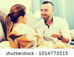 man is offering cup of tea for... | Shutterstock . vector #1014773515