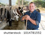 adult farmer is standing at her ... | Shutterstock . vector #1014781552