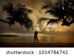 Silhouette Of Kissing Couple...