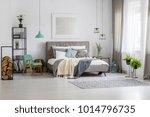 green lamp above retro chair...   Shutterstock . vector #1014796735