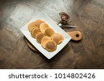 pancakes on a wooden board with ... | Shutterstock . vector #1014802426